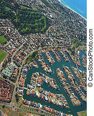 Aerial View of Coastal Town. View of Waterfront Houses