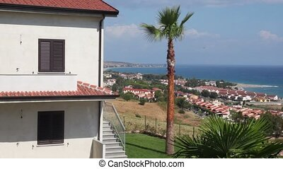 Coastal town placed on sea shore, view from hill at summer...