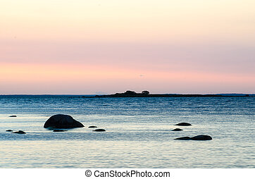 Coastal twilight view with colored sky