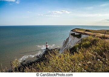 Coastline and lighthouse at Seven Sisters cliffs in England
