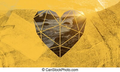 Coastline and rocks in sea through yellow heart shaped ...