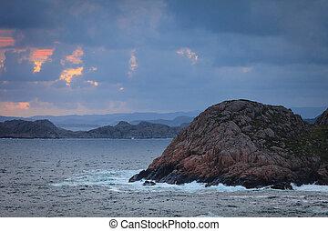 Coastline at sunset in Norway