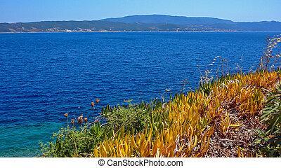 Coastline of Ammouliani island, Athos, Chalkidiki, Greece -...