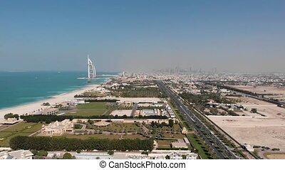 Coastline of Dubai with a view of the hotel Burj Al Arab...