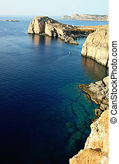 Coastline - Rocky coastline in Lindos bay, Rhodes, Greece.