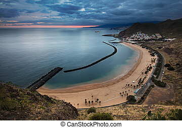 Coastline view of Playa de Las Teresitas beach and San...
