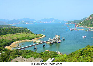 Coastline with mountain ridges in Hong Kong at day time