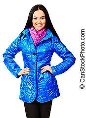coat blue - Fashion model in a coat posing at the studio....