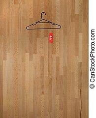 Coat Hanger - A coat hanger isolated against a wooden ...