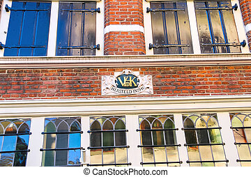 Coat of arms on a facade of an old house in the Dutch town Gorin