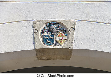 Coat of arms on the wall of a building in Dordrecht. Netherlands
