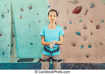 Coating hands in powder magnesium - Climber young woman ...