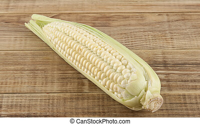 Cob of corn on a wooden background