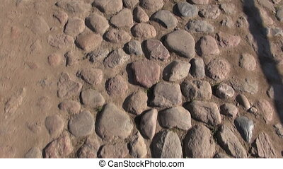Cobble stone pavement - Old cobblestone pavement with metal...