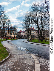 cobble street winding through old town. lovely cityscape in...