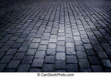 cobbled street floor tile old brick style at night, soft focus