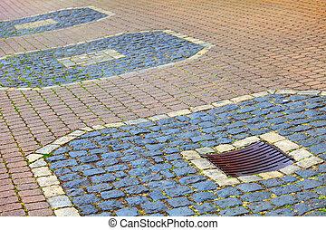 A cobbled surface on the promenade in small city Saarburg, Rheinland-Pfalz, Germany