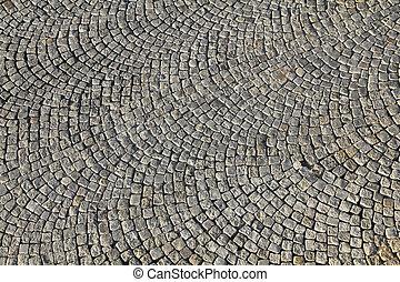 Cobblestone background texture. Cobbled street in Warsaw, Poland.