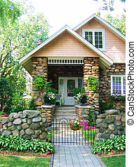 Cobblestone house with pretty garden and path to front door