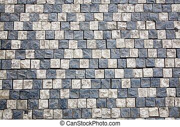 Mosaic of Prague sidewalk. Background texture.