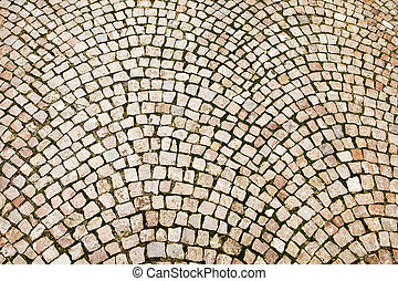 Cobblestones on a Czech street in Prague have been laid out in a pattern of concentric arcs.