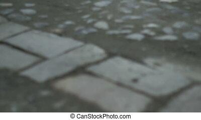 Cobblestone Road Pan and Tilt - Low angle pan and tilt shot...