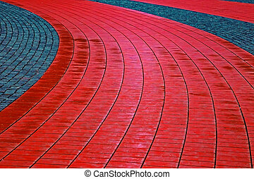 Cobblestone sidewalk made of cubic red and gray stones 1