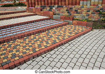 Cobblestone steps - Tiled, colorful, decorative pavement. ...