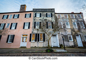 Cobblestone street and old buildings in Charleston, South Carolina.