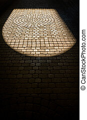 cobblestones in the backlight in a driveway.