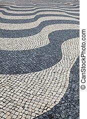Traditional Portuguese cobblestone pattern in Lisbon Portugal