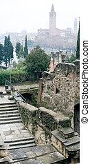 Cobweb morning in Verona, Italy With Santa Anastasia Church and the Teatro romano