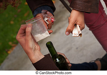 Cocaine dealing, banknotes and a bottle of wine