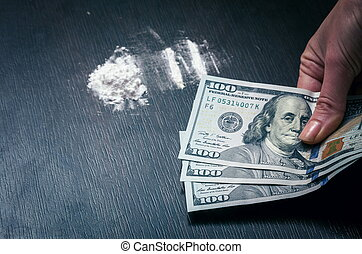 Cocaine powder on the table with money