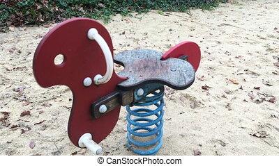 Cockhorse in children park on sand Playground