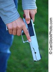 Cocking a Gun