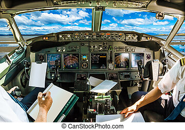 Cockpit in cloudy sky - Cockpit and board of an airplane...
