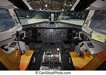 Cockpit of propeller aircraft at the airport