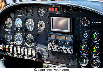 cockpit of an airplane. inside a airplane cockpit, little airplanes cockpit, pilot's view, airplane background
