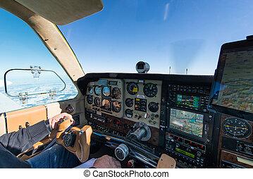 cockpit of old propeller airplane with tablet for navigation