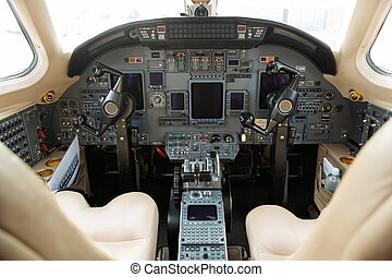 Cockpit Of Private Business Jet - Instrument panels in...
