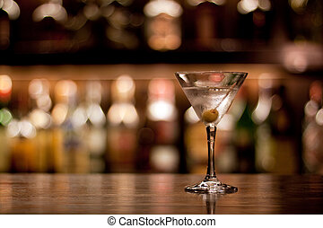cocktail - a cup of martini with olive on a old pub