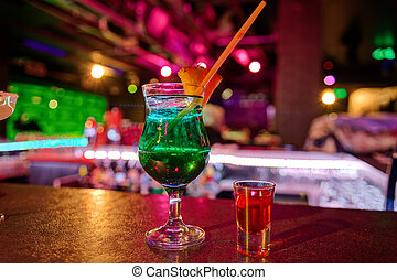 cocktail at bar in a night club with vivid colors