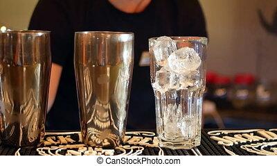 Cocktail bar shaker - Bartender is making cocktail at bar...