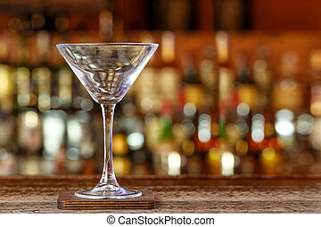 Cocktail glass on the background of the bar