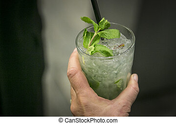 Cocktail glass with hand / Mojito