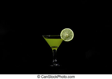 Cocktail goblet with lime on a dark background