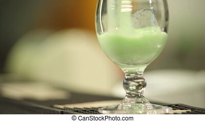 Cocktail - Green cocktail poured into a clear glass