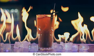 Cocktail in fire on a bar.