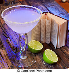 Cocktail in margarita glass on the wooden background